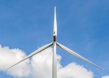Closeup of wind turbine producing alternative energy in wind farm Stock Image