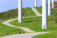 Closeup of wind turbine towers with path Stock Photography