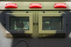 Closeup window and signal lights on military armored vehicle made with solid steel. Closeup window and signal lights on military armored vehicle made with solid royalty free stock photography