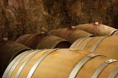 Closeup of Wine Barrels in a Wine Cellar. Closeup of Oak's Barrels for Wine in Old Wine Cellar Stock Image