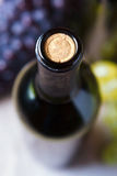 Closeup of wine bottle and cork Royalty Free Stock Images