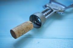 Closeup of wine cork and corkscrew Stock Photos