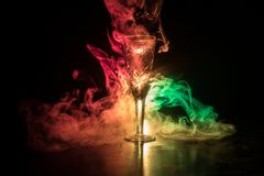 Closeup wine glass with fog at dark background. Beautiful glass with smoke and light royalty free stock photo