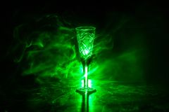 Closeup wine glass with fog at dark background. Beautiful glass with smoke and light royalty free stock photography