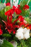 Closeup winter Christmas bouquet in green and red colors stock image