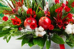 Closeup winter Christmas bouquet in green and red colors stock photo