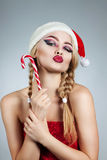 Closeup winter portrait of girl in santa hat. Bright creative makeup. Positive emotions Royalty Free Stock Images