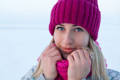 Closeup winter portrait of young girl in pink hat. And scarf Stock Photos