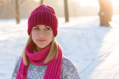 Closeup winter portrait of young girl in pink hat. And scarf Stock Images