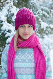 Closeup winter portrait of young girl in pink hat. And scarf Royalty Free Stock Image