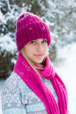 Closeup winter portrait of young girl in pink hat. And scarf Royalty Free Stock Photo