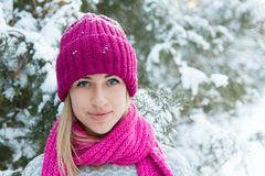 Closeup winter portrait of young girl. In pink hat and scarf Royalty Free Stock Photos