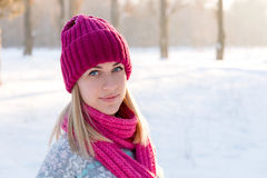 Closeup winter portrait of young girl in pink hat. And scarf Stock Image