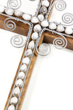 Closeup of Wire Cross and Beads Attached to Wooden Cross Stock Photo
