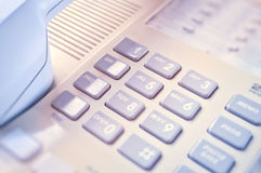 This is closeup of wired desktop telephone Stock Photos