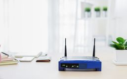 Closeup of a wireless router on living room at home Royalty Free Stock Images