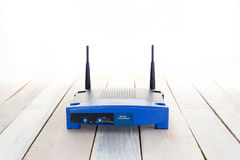 Closeup of a wireless router wifi on wood floor stock images