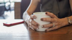 Closeup of beautiful woman's hands. royalty free stock images
