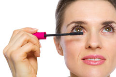 Closeup on woman applying mascara Stock Photo