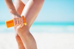 Closeup on woman applying sun screen creme on beach Stock Photo