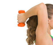Closeup on woman athlete making exercise with dumbbells Stock Images