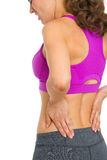 Closeup on woman with back pain Stock Images
