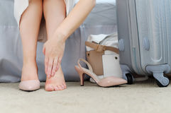 Closeup of woman barefoot with painful toes. High heels shoe fe Royalty Free Stock Images