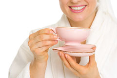 Closeup on woman in bathrobe with cup of tea Stock Images