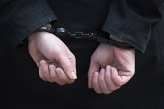 Closeup of woman being handcuffed Stock Photography
