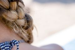 Closeup of woman blonde braided hair stock photography