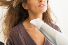 Closeup on woman blow drying hair Royalty Free Stock Photo