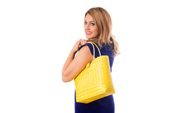 Closeup woman in blue dress with bright tote bag.Isolated. Royalty Free Stock Images