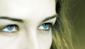 Closeup on woman with blue eyes Royalty Free Stock Photos