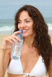 CLoseup of woman with bottle of water Royalty Free Stock Images