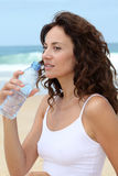 CLoseup of woman with bottle of water Royalty Free Stock Photo