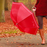 Closeup of woman in brown boots with umbrella. Royalty Free Stock Photography