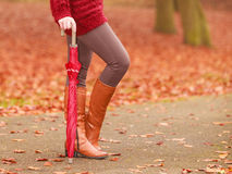 Closeup of woman in brown boots with umbrella. Stock Images