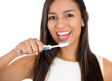 Closeup of woman brushing her teeth with toothpaste and a manual toothbrush. Stock Images