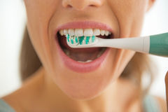 Closeup on woman brushing teeth Stock Photography