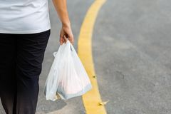 Carry Plastic Bags in Daily Life royalty free stock image