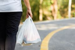Carry Plastic Bags in Daily Life stock image