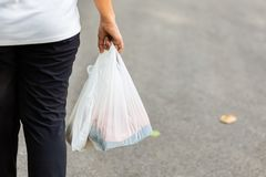 Carry Plastic Bags in Daily Life stock photography