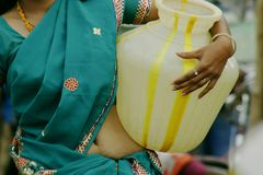 Closeup woman carrying water pots in South India Stock Photography