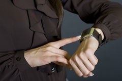 Closeup of a woman checking time. Showing the watch Stock Images