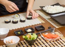 Closeup of woman chef putting japanese sushi roll Royalty Free Stock Image