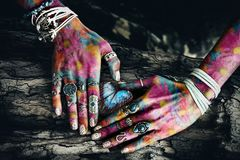Closeup of woman colorful hands on tree surface in heart shape stock photos