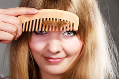 Closeup woman combing her fringe with comb Royalty Free Stock Photos