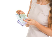 Closeup on woman counting euros Royalty Free Stock Images
