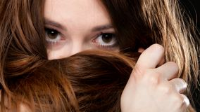 Closeup woman covering face with long hair Royalty Free Stock Photography