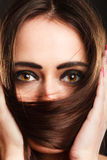 Closeup woman covers the face by long brown hair Stock Photo